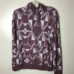 On the Byas maroon pattern hoodie. Small